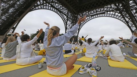 Hundreds of yoga devotees gather under the Eiffel Tower in Paris.