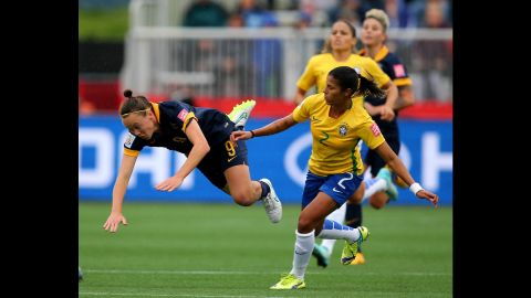 Fabiana of Brazil was given a yellow card after tripping Caitlin Foord.