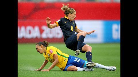 Brazil's Marta slides into Elise Kellond-Knight.