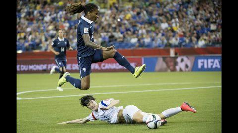 French midfielder Elodie Thomis leaps over South Korea defender Lee Eun-mi.