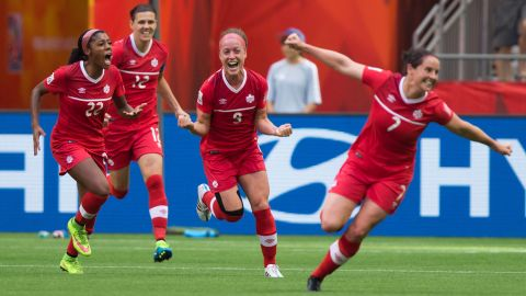 From left, Canada's Ashley Lawrence, Christine Sinclair, Josee Belanger and Rhian Wilkinson celebrate Belanger's goal against Switzerland on Sunday, June 21. Canada won the round-of-16 match 1-0 in Vancouver.