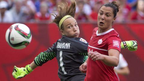 Canada's Melissa Tancredi tries to get a shot past Swiss goalkeeper Gaelle Thalmann.