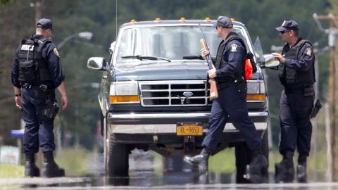 Corrections officers stop a vehicle Monday, June 22, in Owls Head, about 20 to 25 miles west of the prison where Matt and Sweat escaped. The discovery of the escapees' DNA in a cabin re-energized the search for the fugitives.