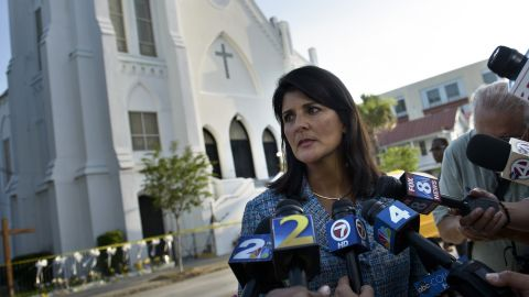 South Carolina Governor Nikki Haley speaks to press outside the Emanuel AME Church June 19, 2015 in Charleston, South Carolina.US police arrested a white high school dropout Thursday suspected of carrying out a gun massacre at one of America's oldest black churches, the latest deadly assault to fuel simmering racial tensions. Authorities detained 21-year-old Dylann Roof, shown wearing the flags of defunct white supremacist regimes in pictures taken from social media, after nine churchgoers were shot dead during a Bible study class on Wednesday evening.
