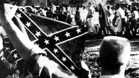 """Dixiecrats resurrected the """"Southern Cross"""" flag as a political symbol around the time President Harry Truman supported efforts to end lynchings and desegregate the military in 1948. During that same period, the Ku Klux Klan began using the flag more widely."""
