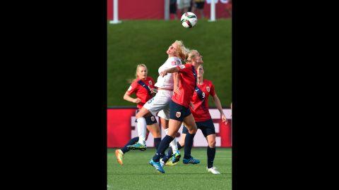 England's Katie Chapman competes with Norway's Solveig Gulbrandsen.
