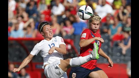 Hegerberg vies for the ball with Lucy Bronze, left.