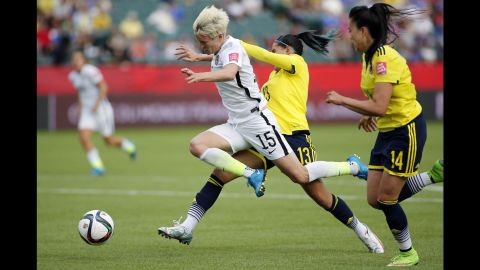 """U.S. midfielder Megan Rapinoe is fouled by Colombia defender Angela Clavijo during a <a href=""""http://www.cnn.com/2015/06/06/sport/gallery/women-worlds-cup-2015/index.html"""" target=""""_blank"""">Women's World Cup</a> match in Edmonton, Alberta, on Monday, June 22. The foul was in the box, leading to a penalty that Lloyd converted into a goal. The United States won the match 2-0 to advance to the quarterfinals."""