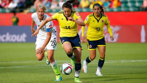 Nataly Arias of Colombia, center, controls the ball near U.S. forward Abby Wambach.