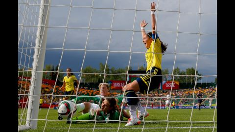 U.S. forward Abby Wambach kicks the ball away from goalkeeper Catalina Perez. Wambach was called offside on the play.