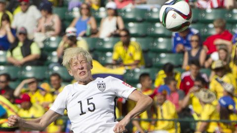 Rapinoe heads the ball against Colombia.