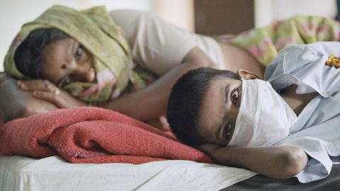 A patient with plague symptoms, foreground, awaits test results with his mother at New Delhi's Disease Hospital in 1994. Pneumonic plague, which infects the lungs, is the most serious form of the disease and the only way it can spread directly between people. A plague outbreak in India in 1994 was among the most serious in the world in recent decades.