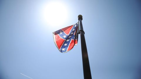 The Confederate flag is seen flying on the Capitol grounds a day after South Carolina Gov. Nikki Haley announced that she will call for the Confederate flag to be removed on June 23, 2015 in Columbia, South Carolina.