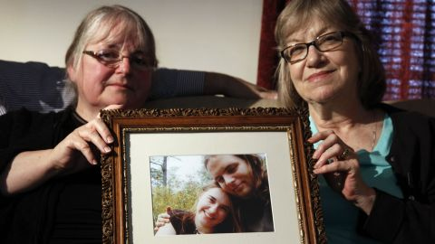 Mothers Linda Boyle, left, and Lyn Coleman hold photo of their married children, Joshua Boyle and Caitlin Coleman, who were kidnapped by the Taliban in late 2012. Coleman was pregnant when she was kidnapped and is believed to have had a child in captivity.