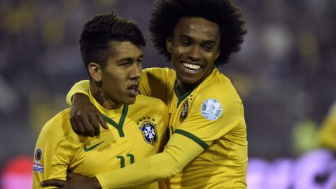Firmino (left) is congratulated by his teammate Willian after scoring the winning goal against Venezuela in the Copa America. Liverpool have signed the 23-year-old for around $45 million from German Club Hoffenheim.