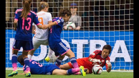Japan goalkeeper Ayumi Kaihori dives for a save during a round-of-16 match in Vancouver on Tuesday, June 23. Japan defeated the Netherlands 2-1 to advance to the quarterfinals of the tournament.