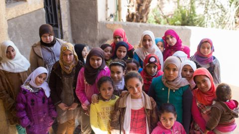 U.N. agencies have adopted a school-based model to try to educate girls about the procedure. Here, in a photo provided to CNN by the UNFPA, a group of girls stand outside the Society of Islamic Center near Sohag on January 31.