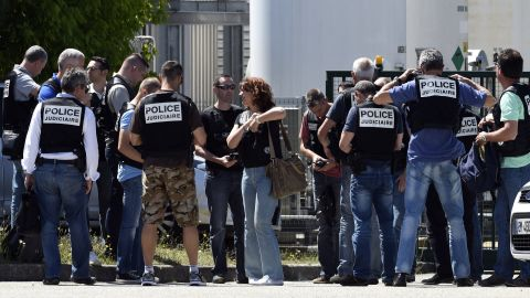Police secure the entrance of the Air Products company on June 26.