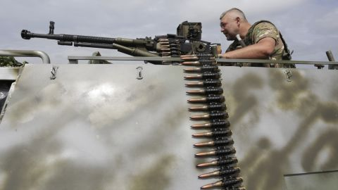 A man with a machine gun is among the Ukrainian troops standing guard in Krimskoe town of Luhansk, Ukraine, on June 25.