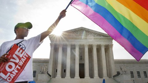 """Carlos McKnight of Washington waves a flag in support of same-sex marriage outside the U.S. Supreme Court on June 26, 2015. <a href=""""http://www.cnn.com/2015/06/26/politics/supreme-court-same-sex-marriage-ruling/index.html"""">The Supreme Court ruled 5-4</a> that states cannot ban same-sex marriage, handing gay rights advocates their biggest victory yet. See photos from states that approved same-sex marriage before the nationwide ruling:"""