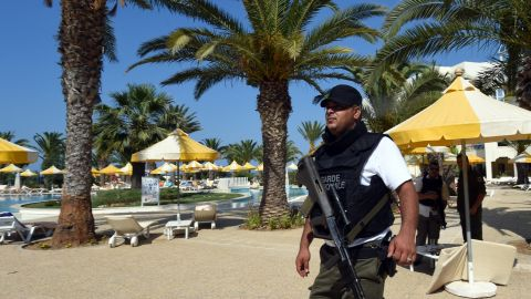 A Tunisian security member stands next to a swimming pool at the resort town of Sousse, a popular tourist destination 140 kilometres (90 miles) south of the Tunisian capital, on June 26, 2015, following a shooting attack. At least 27 people, including foreigners, were killed in a mass shooting at a Tunisian beach resort packed with holidaymakers, in the North African country's worst attack in recent history. AFP PHOTO / FETHI BELAID        (Photo credit should read FETHI BELAID/AFP/Getty Images)