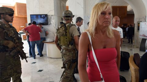 Tunisian security forces evacuate people from the Imperial hotel in the resort town of Sousse, a popular tourist destination 140 kilometres (90 miles) south of the Tunisian capital, on June 26, 2015, following a shooting attack. At least 27 people, including foreigners, were killed in a mass shooting at a Tunisian beach resort packed with holidaymakers, in the North African country's worst attack in recent history. AFP PHOTO / FETHI BELAID        (Photo credit should read FETHI BELAID/AFP/Getty Images)