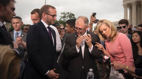 """James Obergefell, the lead plaintiff in the case brought before the Supreme Court, <a href=""""http://www.cnn.com/videos/us/2015/06/26/obama-victory-call-same-sex-marriage-plaintiff-sot.cnn"""">listens to a phone call from President Barack Obama</a> after the landmark decision on June 26."""