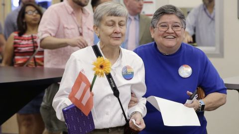 Jaque Roberts, left, and her partner of 31 years, Carmelita Cabello, arrive at the Travis County building in Austin, Texas, for a marriage license on June 26.