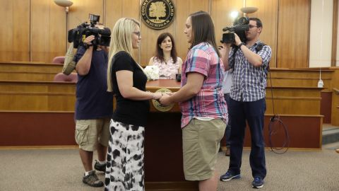 Oakland County Clerk Lisa Brown, center, marries Breanne Brodak, left, and Cortney Tucker in Pontiac, Michigan, on June 26.