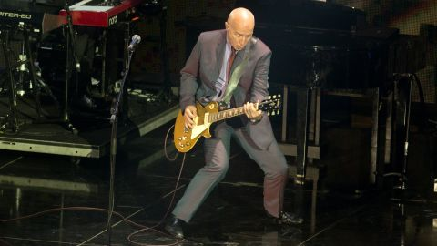 """Scottish Live Aid co-founder and performer Midge Ure still tours internationally. Seen here in 2014, Ure recently told <a href=""""http://www.mirror.co.uk/3am/celebrity-news/live-aid-founder-midge-ure-5920506"""" target=""""_blank"""" target=""""_blank"""">The Mirror </a>about his battles with substance abuse before making a new life with his yoga-teacher wife and four daughters."""