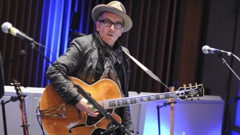 """In the decades after Live Aid, Elvis Costello joined the ranks of the<a href=""""https://rockhall.com/inductees/elvis-costello-the-attractions/"""" target=""""_blank"""" target=""""_blank""""> Rock and Roll Hall of Fame</a>, and in <a href=""""http://news.bbc.co.uk/1/hi/entertainment/6164859.stm"""" target=""""_blank"""" target=""""_blank"""">2003, married jazz singer Diana Krall</a>."""