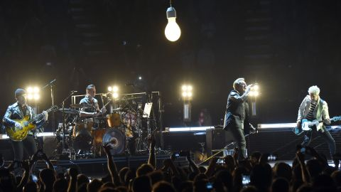 """This iconic band's Live Aid show led to a memorable moment when frontman Bono jumped offstage <a href=""""http://www.thesun.co.uk/sol/homepage/news/109444/How-U2-Bono-saved-me.html"""" target=""""_blank"""" target=""""_blank"""">to help a fan who was being crushed</a> by the crowd at London's Wembley Stadium. In 2015, U2 launched a concert tour of North America and Europe, including this stop in Inglewood, California."""