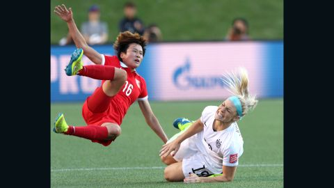 China's Lou Jiahui collides with U.S. defender Julie Johnston.