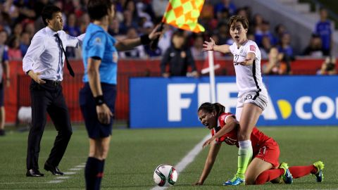 U.S. defender Meghan Klingenberg stands over China's Wang Lisi during a Women's World Cup match in Ottawa on Friday, June 26. The United States won 1-0 to advance to the semifinals.