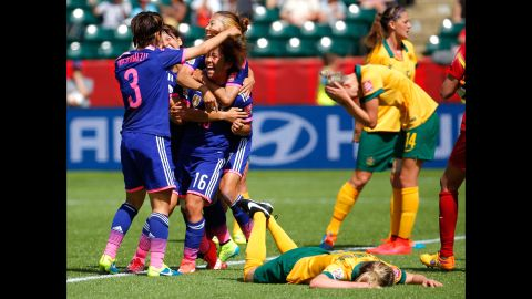 Japanese players celebrate a goal scored by Mana Iwabuchi (No. 16) during a match against Australia on June 27. It was the only goal scored in the quarterfinal match, which was played in Edmonton, Alberta.