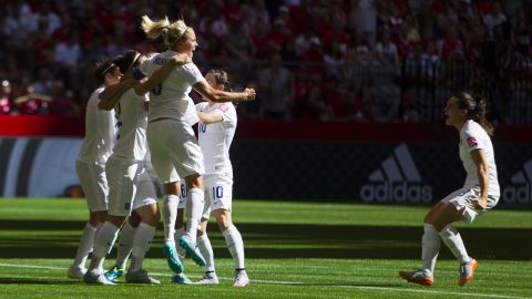 England players celebrate a goal during their 2-1 victory over Canada in the Women's World Cup on Saturday, June 27. The victory in Vancouver, British Columbia, gave England its first-ever trip to the semifinals.
