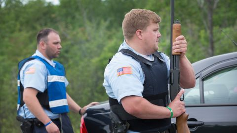 Department of Corrections officers man a roadblock in Malone, New York, on Saturday, June 27.