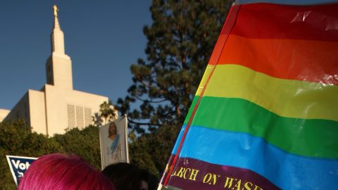 Caption:LOS ANGELES, CA - NOVEMBER 6: Phelan Lecklenburg, 21 months, waves a rainbow flag as she and her lesbian mother Jean MacDonald join hundreds of supporters of same-sex marriage near the Los Angeles Mormon Temple (L) to march for miles in protest against the Church of Jesus Christ of Latter-day Saints November 6, 2008 in Los Angeles, California. The protest, which began outside the Los Angeles Mormon temple, opposes massive financial contributions to the Proposition 8 campaign, which voters passed and which changes the California Constitution to make gay marriage illegal. When same-sex marriages became legal in California on June 16, conservative churches vowed to fight it and successfully passed Proposition 8 with funds that dwarfed that of their opponents. Demonstrators say the Mormon Church contributed some $35 million to pass the measure. (Photo by David McNew/Getty Images)