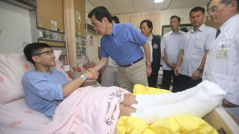 Taiwanese President Ma Ying-jeou shakes hands with a victim injured in an accidental explosion during a music concert in New Taipei City, Taiwan, on June 28, 2015.