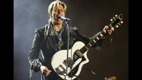 """Seen performing in 2004, Bowie sang four solo songs at Live Aid. He <a href=""""http://www.cnn.com/2016/01/11/entertainment/david-bowie-death/"""" target=""""_blank"""">died in 2016 </a>at age 69 after losing a battle with cancer."""