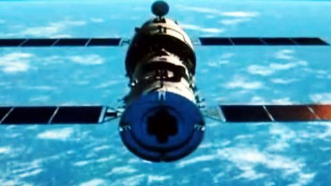 This TV grab of animated video illustrates the docking of the Tiangong-1 space lab module and the Shenzhou-8 spacecraft in space. China successfully carried out its first docking exercise in November 2011 between two unmanned spacecraft, a key test of the rising power's plans to secure a long-term manned foothold in space. China plans to have its own space station to rival the ISS in the early 2020s.