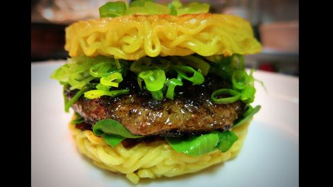"""This beef patty sandwiched between two """"buns"""" of ramen noodles can be devoured on both coasts.  Ramen Burger has restaurants in two locations -- New York and  Los Angeles."""