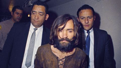 """<a href=""""https://www.cnn.com/2013/09/30/us/manson-family-murders-fast-facts/index.html"""" target=""""_blank"""">The Manson Family murders</a> of Sharon Tate, the pregnant wife of filmmaker Roman Polanski, and others in the summer of 1969 shocked and captivated America, setting the tone for one of the most violent decades in the country's history as covered in the """"Crimes and Cults"""" episode of CNN's """"<a href=""""https://www.cnn.com/shows/the-seventies"""" target=""""_blank"""">The Seventies</a>."""" Here, Charles Manson is escorted to his arraignment on conspiracy-murder charges in connection with the case."""