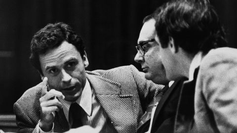 """Theodore """"Ted"""" Bundy, left, makes a point to members of his defense team at his trial in Miami in June 1979.  Bundy raped and killed at least 16 young women in the early to mid-1970s, and was convicted of three Florida slayings, including that of a 12-year-old girl. He later confessed to killing more than 30 women and girls. """"He was handsome, he was very involved with politics, he was educated, he was in law school. It didn't seem like the glassy-eye lunatic that many Americans believed serial killers would be,"""" according to author James Alan Fox."""