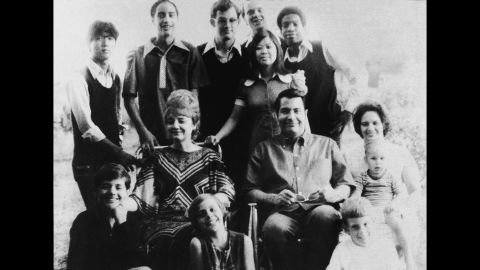 Portrait of American religious leader Jim Jones, the founder of the People's Temple, and his wife, Marceline Jones, seated in front of their adopted children and next to his sister-in-law, right, with her three children. In 1977, Jones relocated the People's Temple from San Francisco, California, to Jonestown, Guyana. He led the mass suicide of over 900 followers on November 18, 1978, before dying of a gunshot wound later that day.