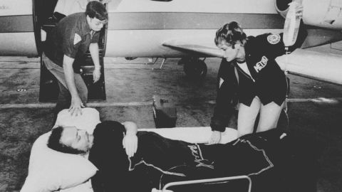 """Larry Flynt, owner of Hustler magazine, lies on a stretcher in Atlanta, April 14, 1978, as attendants prepare to load him on board a hospital plane. Flynt was shot by serial killer and white supremacist <a href=""""http://www.cnn.com/2013/11/18/justice/death-row-interview-joseph-paul-franklin/"""">Joseph Paul Franklin</a> for publishing pornographic photos of a black man with a white woman. The injury left Flynt permanently paralyzed from the waist down. Franklin was convicted of six murders and claimed responsibility for as many as 22. He was executed in November 2013."""