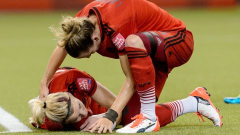 Germany's Alexandra Popp, left, clashed heads with American Morgan Brian early in the match. Both players received treatment and returned to action.