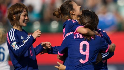 Japanese players celebrate their first-half goal against England during a Women's World Cup semifinal on Wednesday, July 1. Japan, the defending World Cup champions, won 2-1 after a late-minute own goal by England's Laura Bassett.