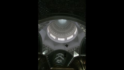 The dome of the shrine over Khomeini's mausoleum. The exterior of the newly constructed dome is still under scaffolding, the final golden tiles being laid.