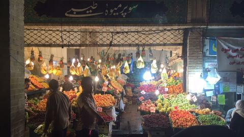 Market stalls heave with fresh fruit in Tehran, aiming to satisfy observant Muslims who have been fasting all day.